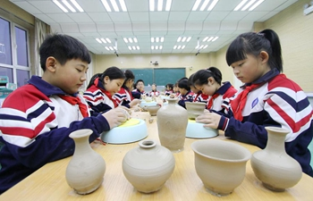 Students learn to make ceramic ware at school in China's Hebei